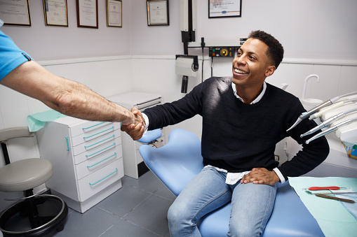 Dentist shaking patients hand at Metropolitan Dental Specialty Group