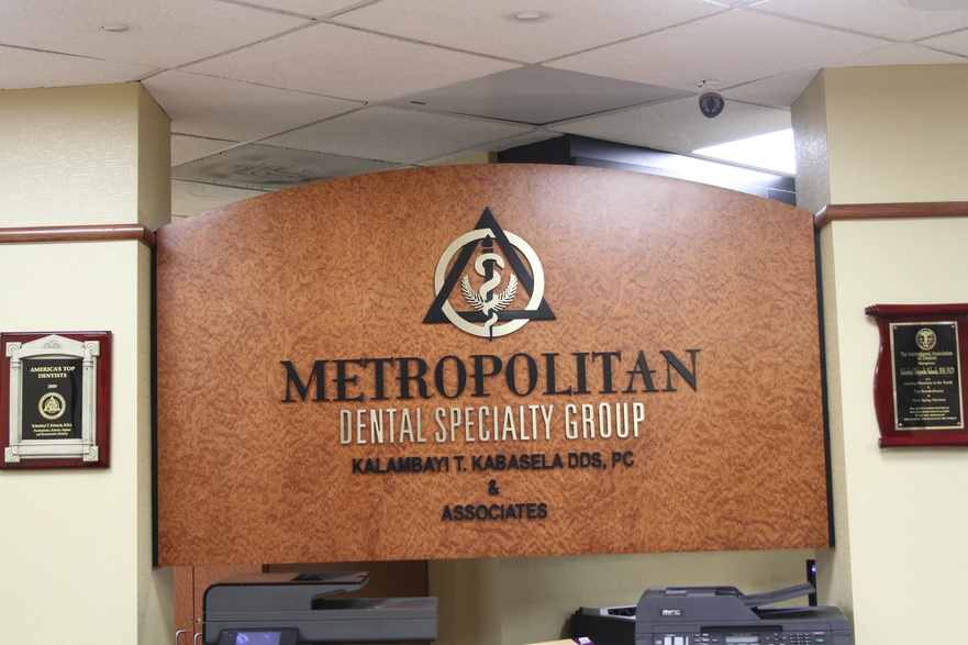 Image of the check-in area that reads Metropolitan Dental Specialty Group on the wall