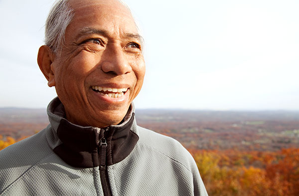 Elderly man smiling with All-on-4 from Metropolitan Dental Specialty Group