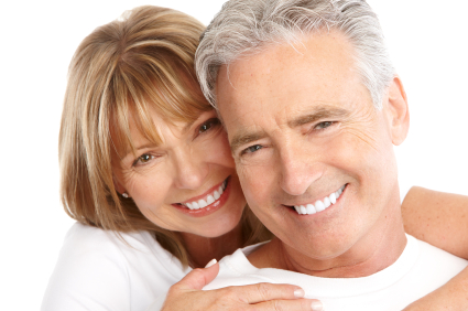 Elderly man and wife showing off their new smile from Metropolitan Dental Specialty Group